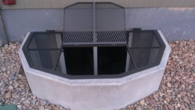 window well covers with trap doors made by Colorado Custom Welding